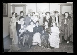 Group of costumed people in sitting room
