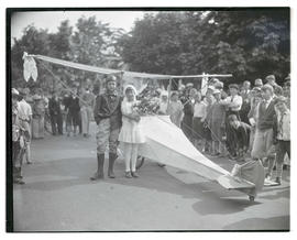 Boy and girl with airplane-shaped parade float