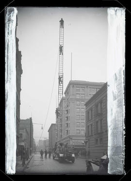 Firefighters on ladder, Pine Street, Portland
