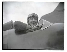 Woman seated in airplane cockpit