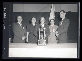 Group posing with 4-H Club trophy