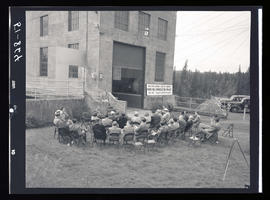 Group seated outside building at River Mill Hydroelectric Project