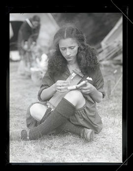 Unidentified member of Camp Fire Girls using bead loom