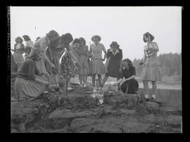 Marylhurst College students roasting hot dogs on beach, opening day, 1943?