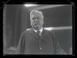 Unidentified man at train station, head and shoulders portrait