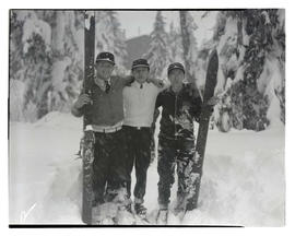 Three skiers in the snow