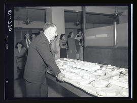 Man with slices of cake at an office party