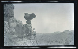 William L. Finley photographing a balancing rock
