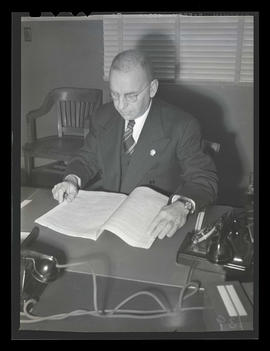Albina Engine & Machine Works vice president L. R. Hussa at desk