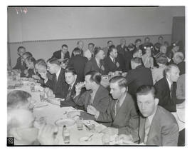 People eating meal during plumbers meeting at Norse Hall, Portland