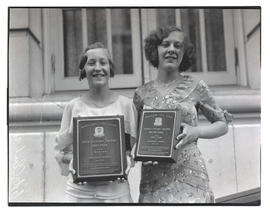 Velma Dick and Doris Lyndes, holding award plaques from Portland City Club