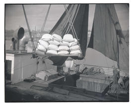 Sacks of flour being loaded onto ship