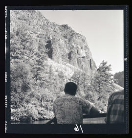 Man looking at rock formations at Cove Palisades State Park