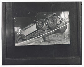 Photograph of car being pulled from water