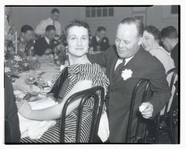 Unidentified man and woman at dinner party?