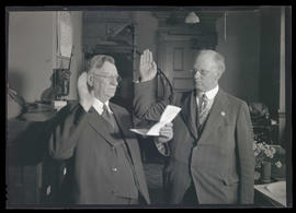 Two unidentified men at oath ceremony