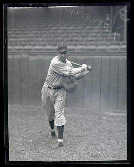 Mitt flies toward baseball player J. Donovan
