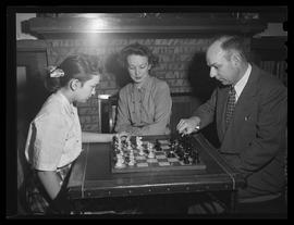 Chess master Arthur Dake playing chess with daughter, Marjorie