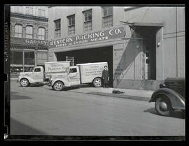 Delivery trucks parked outside Western Packing Company, Portland