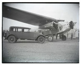 Car parked next to Fokker Trimotor F-10 'Deluxe'