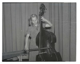 Young woman playing double bass