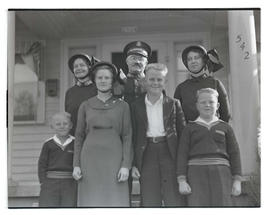 Salvation Army Major Harold Madsen with family and assistant