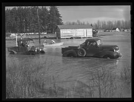 Automobiles navigating Eugene flood