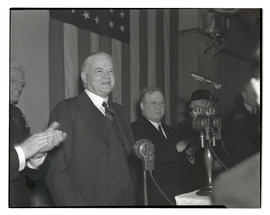 Herbert Hoover receiving applause at Lincoln Day banquet, Multnomah Hotel, Portland