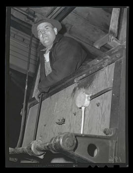 Worker looking over edge of balcony, Albina Engine & Machine Works, Portland