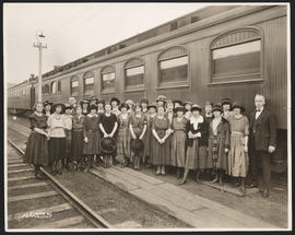 Group Posing in front of Train