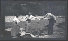 Man and women by river