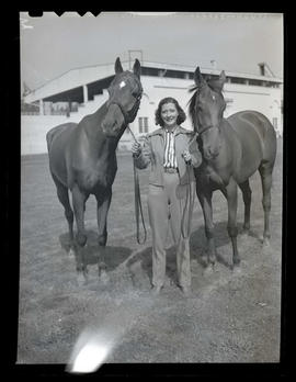 Babe Steel with two racehorses