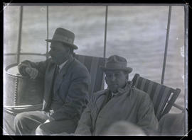 Two Unidentified Men on a Boat