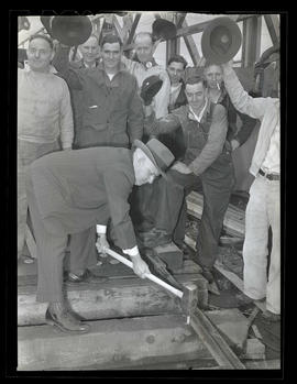 George Rodgers and workers marking completion of railway spur at Albina Engine & Machine Work...