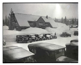 Cars outside Battle Axe Inn during winter Government Camp, Oregon