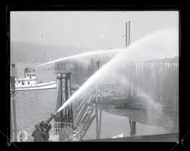 Fireboats spraying water toward dock