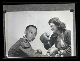 Composite photograph of two workers boxing at Albina Engine & Machine Works, Portland