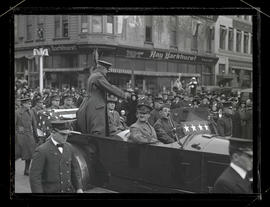 General John J. Pershing waving to crowd during parade in Portland