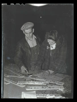 Workers marking specifications on strips of wood, Albina Engine & Machine Works, Portland