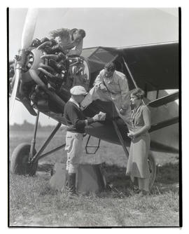 Tex Rankin, Steve Carney, Dorothy Hester, and unidentified man with plane
