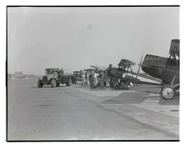 Row of airplanes and fuel truck at Swan Island airport, Portland