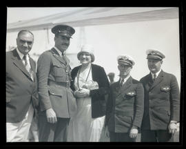 George L. Baker and four unidentified people
