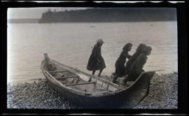 Unidentified children beside a canoe