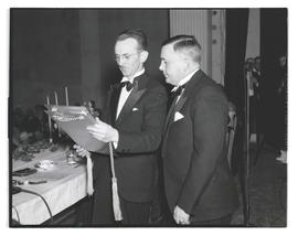 Joseph K. Carson and unidentified man looking at plaque