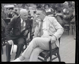 Charles H. Martin and Johnson, seated at outdoor event