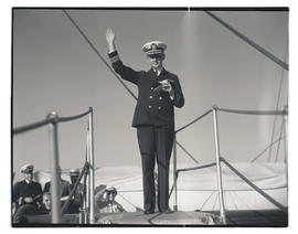Commander Louis J. Gulliver waving farewell from USS Constitution
