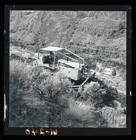 Caterpillar machine working at Cove Palisades State Park area