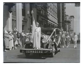 Girl in Statue of Liberty costume riding on Townsend Plan car in parade