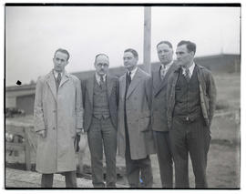 Group of men, possibly at livestock show