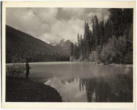 Man fishing in Avalanche Lake, Glacier National Park